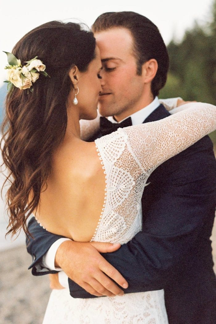 Bride wearing Grace Loves Lace Gaia Earrings embracing groom