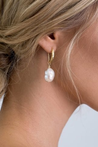 Close-up of bride wearing Grace Loves Lace Gaia Earrings