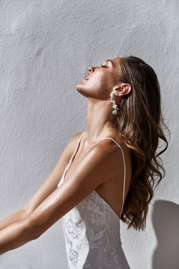 Bride wearing Grace Loves Lace Essie Earrings leaning head back