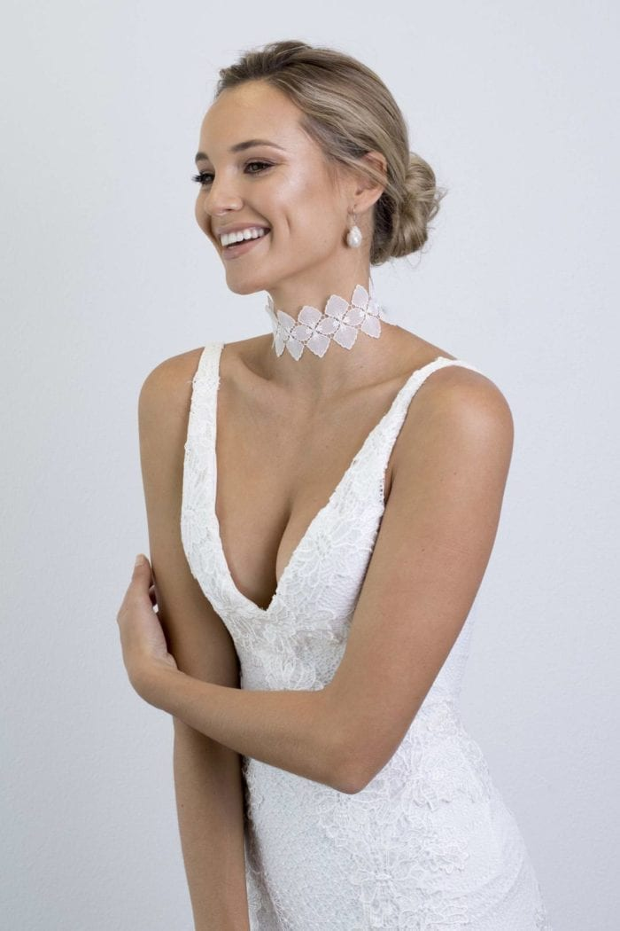Bride wearing Grace Loves Lace Bloom Choker looking to the side laughing
