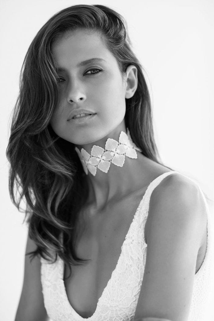 Black and white shot of bride wearing Grace Loves Lace Bloom Choker