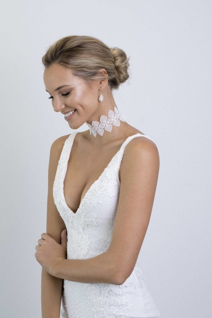 Bride wearing Grace Loves Lace Bloom Choker looking at the floor smiling
