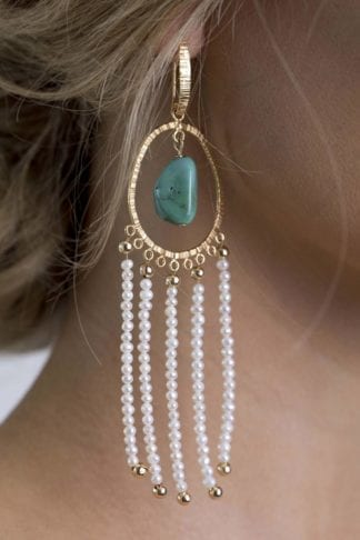 Close-up of bride wearing Grace Loves Lace Amilla Earrings in Pearl Turquoise and Gold