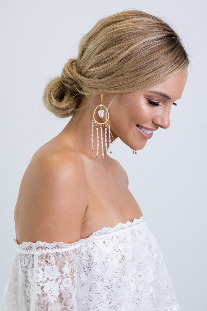 Side shot of bride wearing Grace Loves Lace Amilla Earrings in White Pearl and Gold