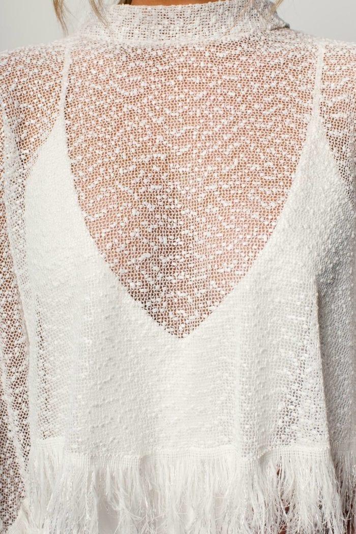 Close-up of bride wearing Grace Loves Lace Pierre Cape
