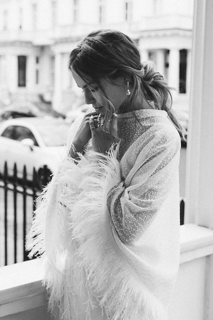 Black and white shot of bride wearing Grace Loves Lace Pierre Cape