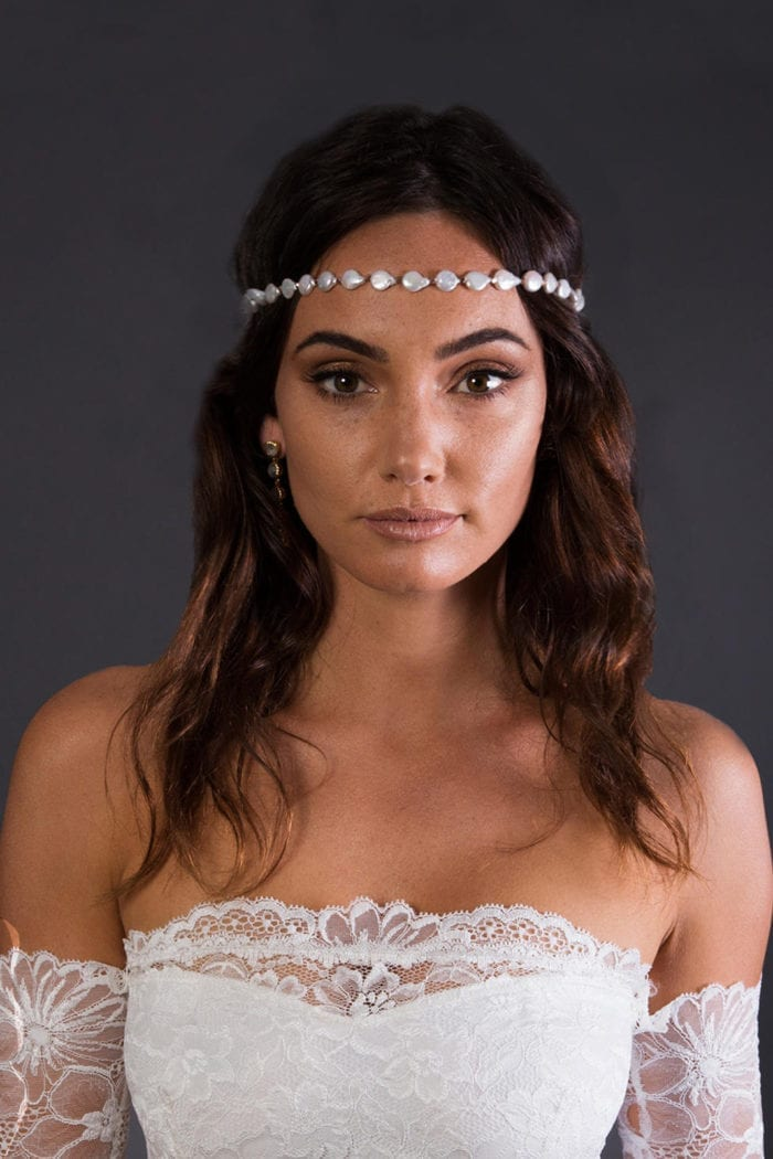 Close up of bride wearing Grace Loves Lace Venus Headpiece