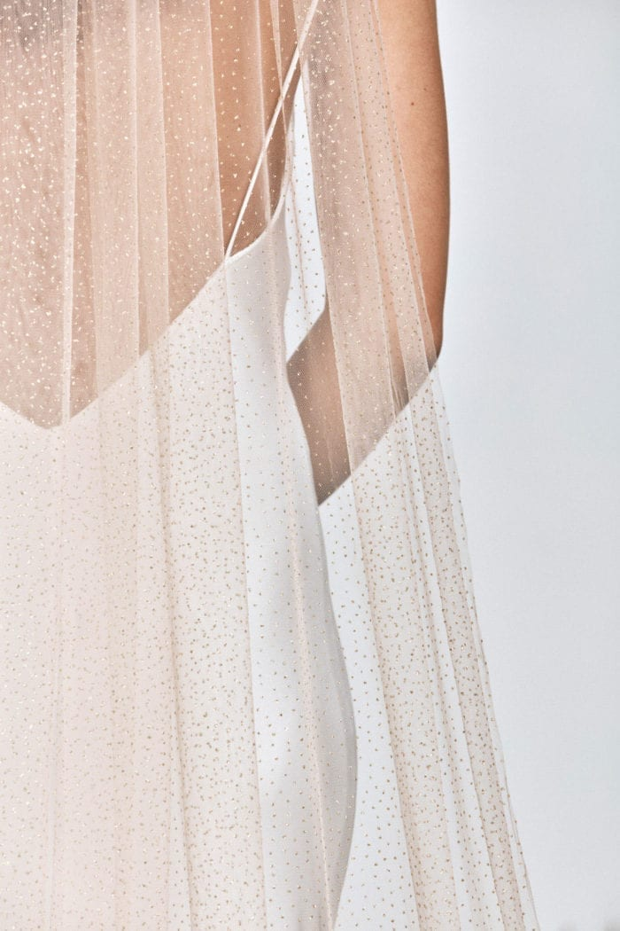 Close up shot of bride wearing Grace Loves Lace Shimmy Veil in Nude Gold