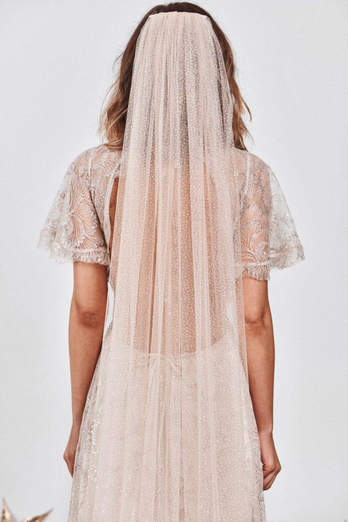 Back shot of bride wearing Grace Loves Lace Shimmy Veil Nude Silverin