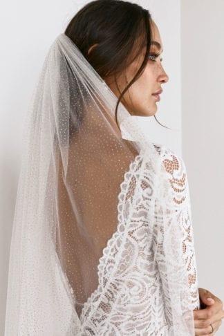 Back shot of bride wearing Grace Loves Lace Shimmy Veil in Ivory Gold