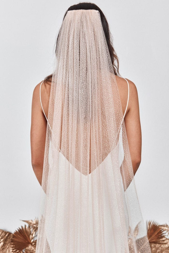 Back shot of bride wearing Grace Loves Lace Shimmy Veil in Nude Silver