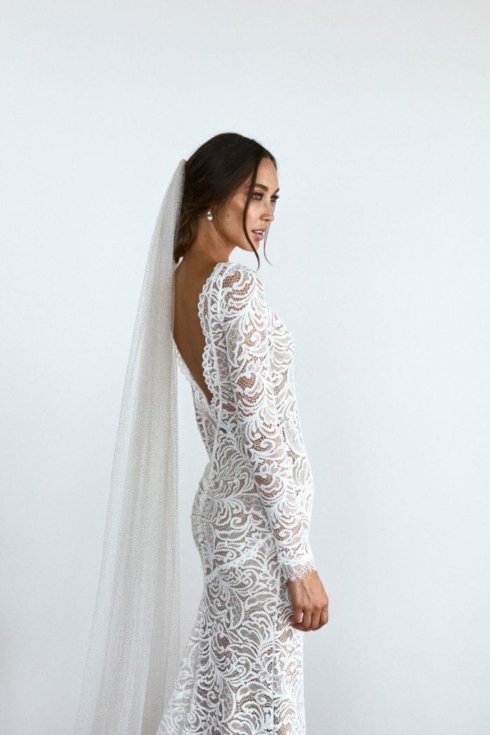 Side shot of bride wearing Grace Loves Lace Shimmy Veil in Ivory Gold