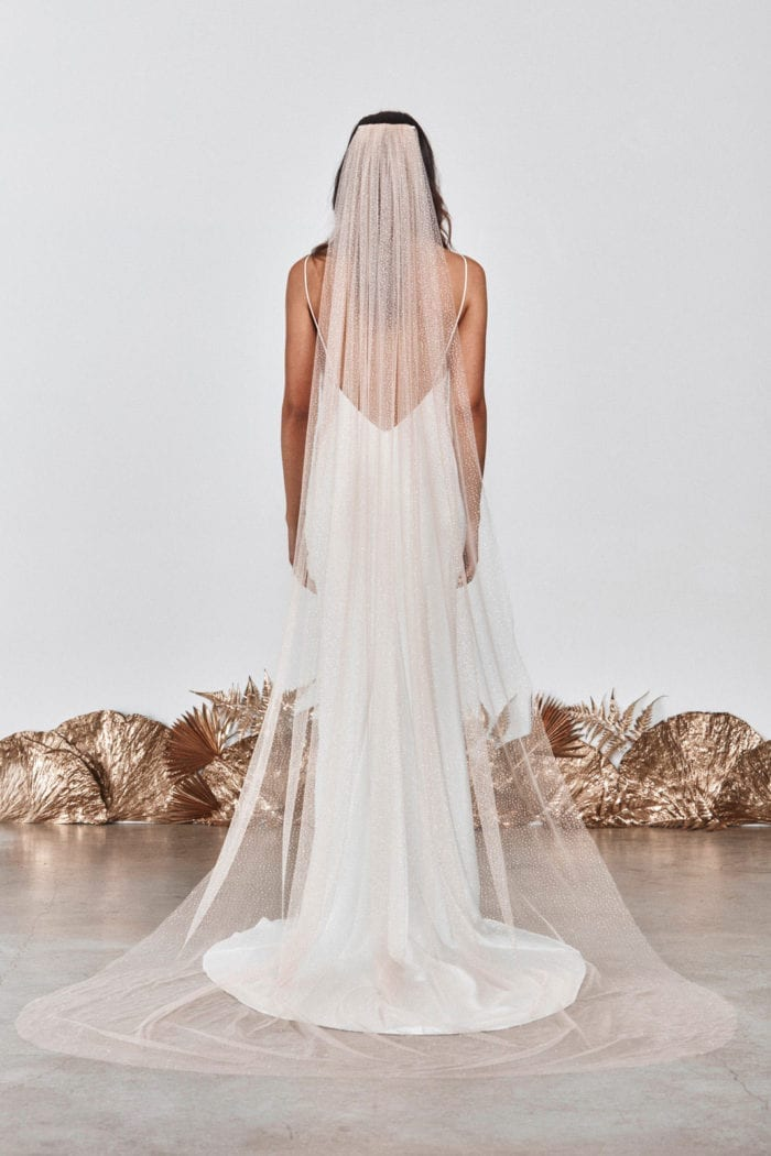 Back shot of bride wearing Grace Loves Lace Shimmy Veil in Nude Gold