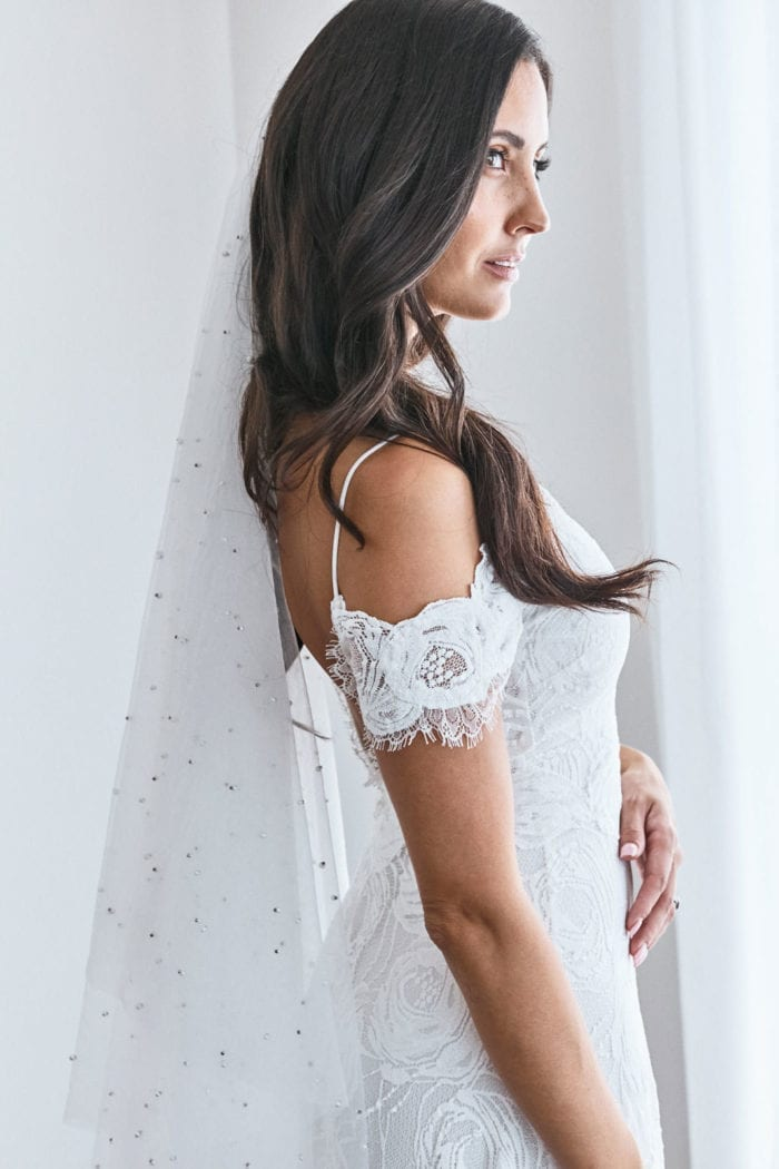 Side shot of bride wearing Grace Loves Lace Pearly Blusher Veil