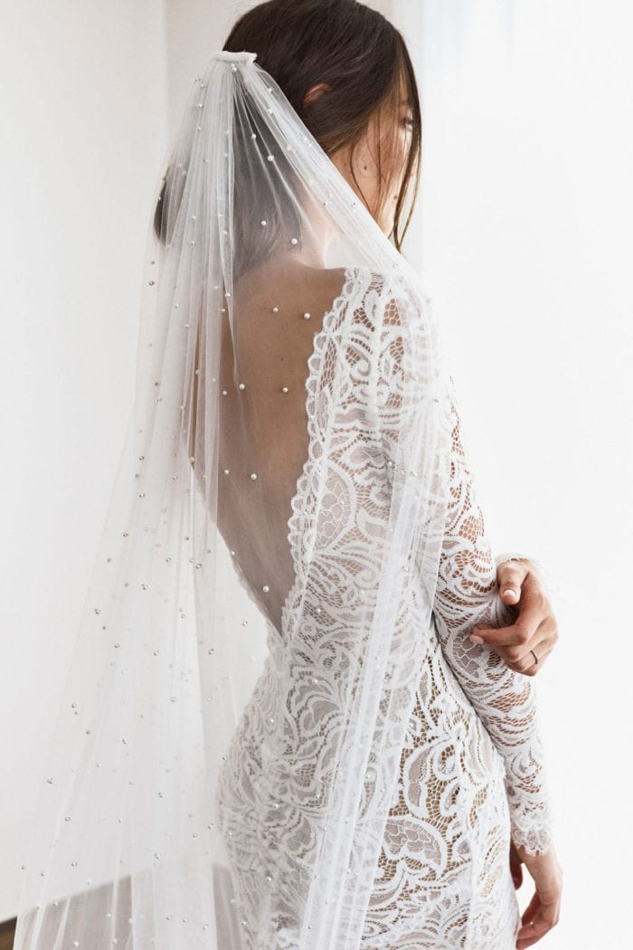 Back shot bride wearing Grace Loves Lace Pearly Long Veil