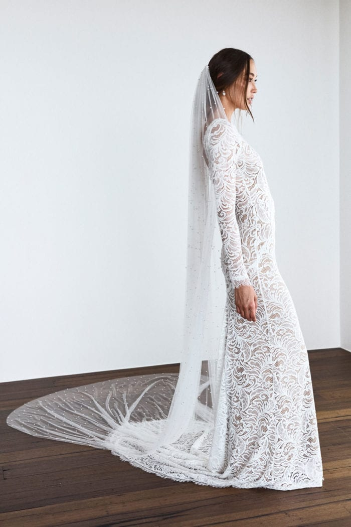 Side shot of bride wearing Grace Loves Lace Pearly Long Veil