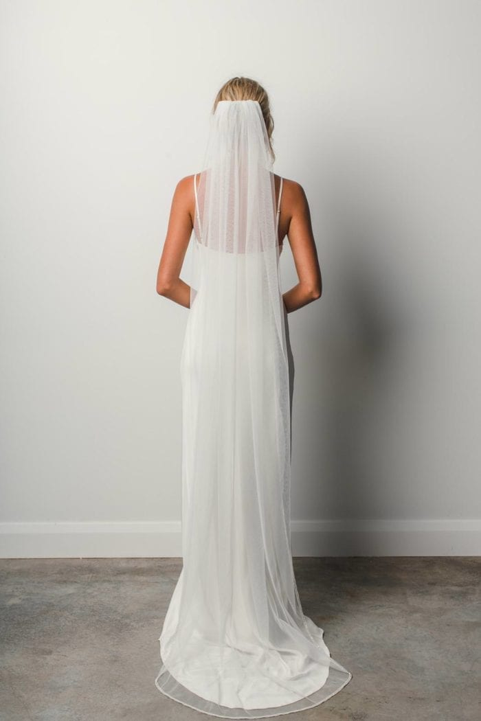 Back shot of bride wearing Grace Loves Lace Mandala Veil
