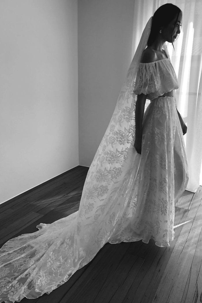 Black and white side shot of bride wearing Grace Loves Lace Loyola Veil