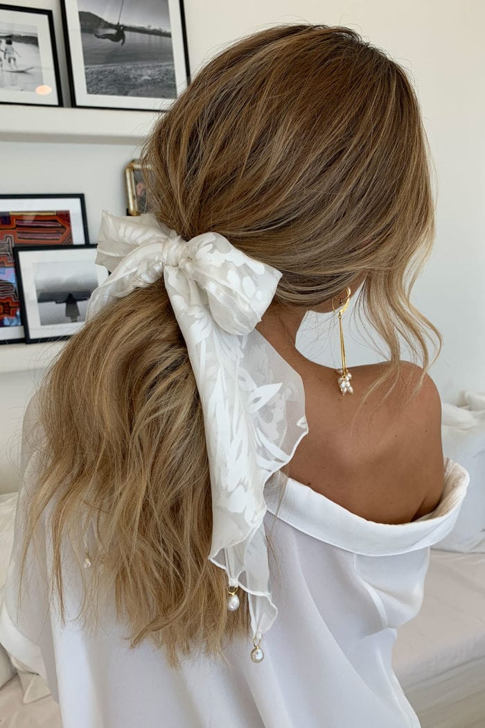 Back shot of bride wearing Grace Loves Lace Loyola Pope Scarf wrapped around hair