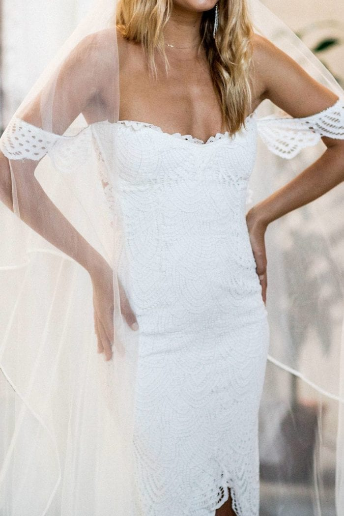 Bride wearing Grace Loves Lace Kinga Veil with hands on hips