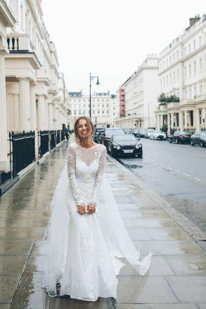 Bride wearing Grace Loves Lace Kinga Veil on rainy street