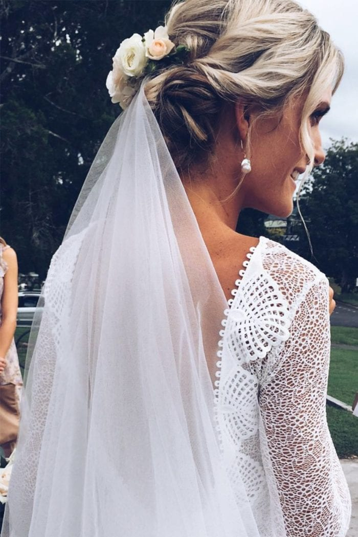 Back shot of bride wearing Grace Loves Lace Kinga Veil and flowers in hair