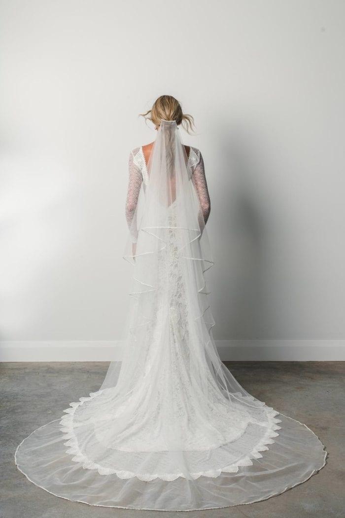 Back shot of bride wearing Grace Loves Lace Kinga Veil