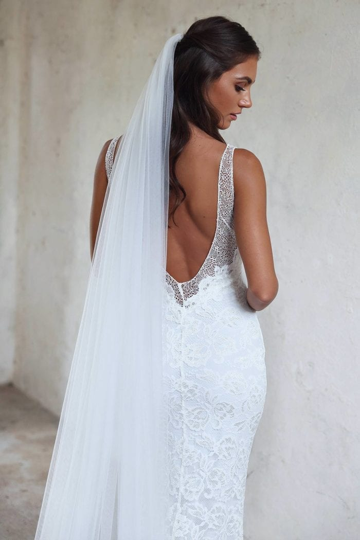 Back shot of bride wearing the Grace Loves Lace Henri Veil looking over her shoulder