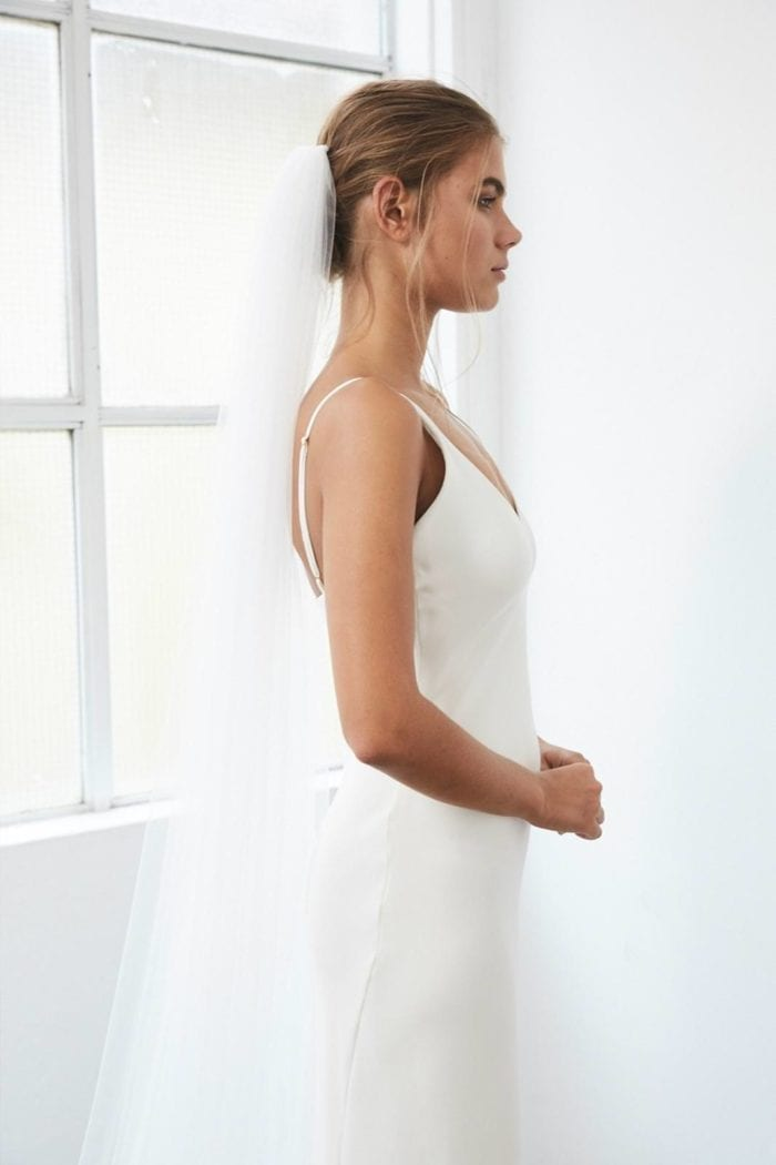 Side shot of bride wearing the Grace Loves Lace Henri Veil