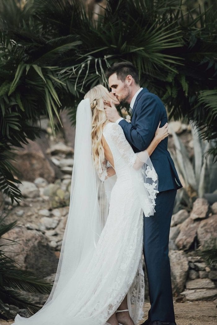 Bride wearing the Grace Loves Lace Henri Veil while kissing groom