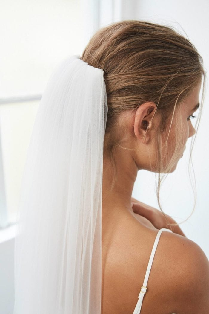 Close-up shot of bride wearing the Grace Loves Lace Henri Veil