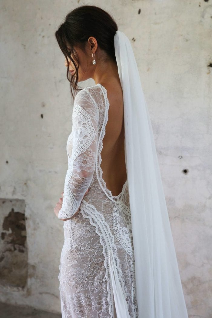 Side shot of bride wearing Grace Loves Lace Gabriela Veil