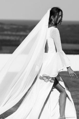 Bride wearing Grace Loves Lace Gabriela Veil as she walks along a beach