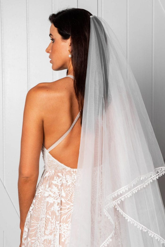 Back shot of bride wearing Grace Loves Lace Fox Veil looking over shoulder