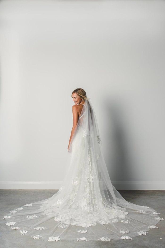 Back shot of Bride wearing Grace Loves Lace Fleur Veil looking over shoulder