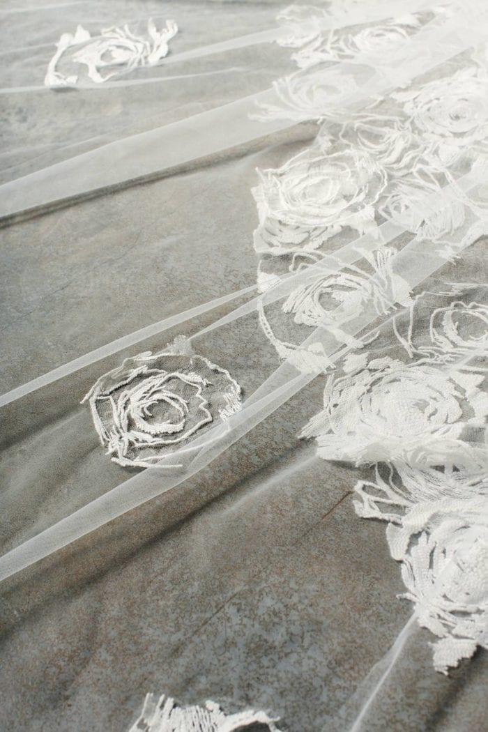 Close-up shot of Grace Loves Lace Fleur Veil rose motif
