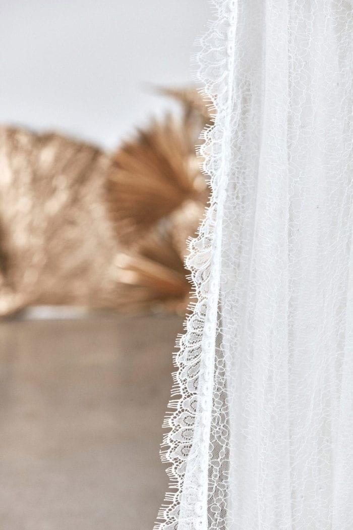 Close-up shot of Grace Loves Lace Chantilly Veil lace trim