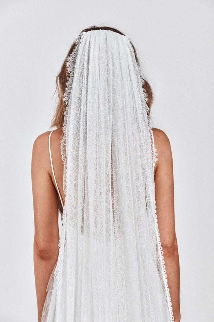 Back shot of bride wearing Grace Loves Lace Chantilly Veil