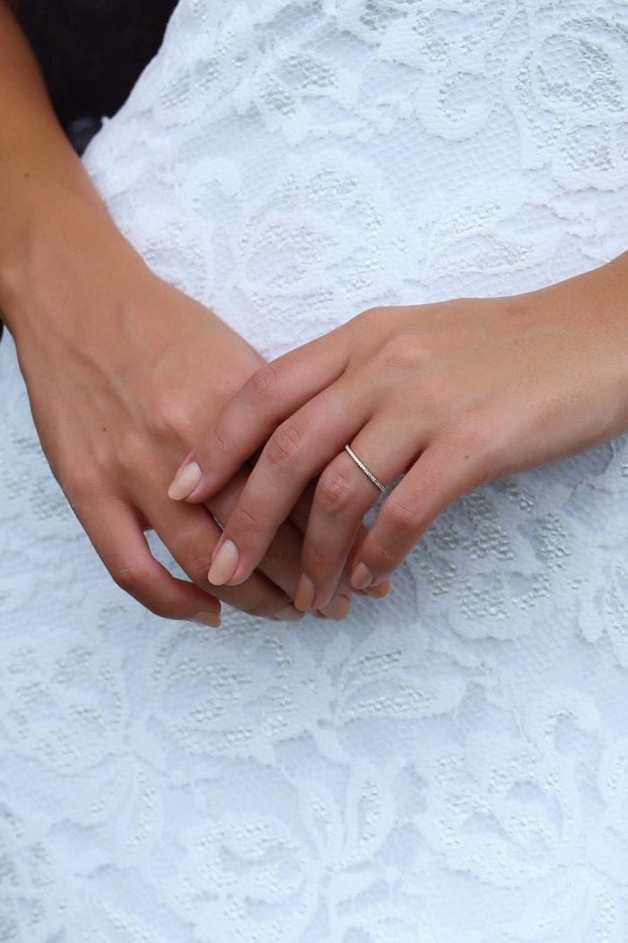 Close-up of bride wearing Grace Loves Lace Queenie Band