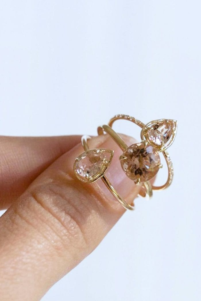 Close-up of bride holding Grace Loves Lace Poppy Ring