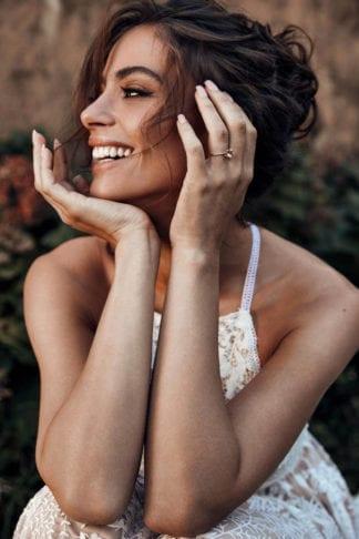 Bride wearing Grace Loves Lace Poppy Ring