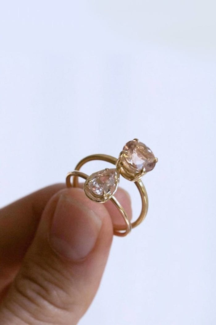 Close-up of bride holding Grace Loves Lace Harper Ring