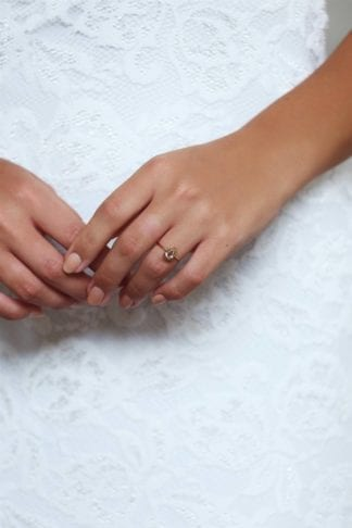 Close-up of bride wearing Grace Loves Lace Harper Ring