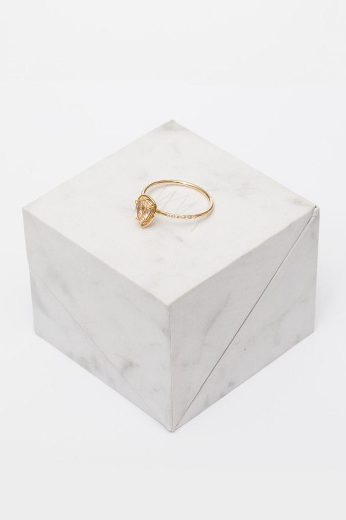 Grace Loves Lace Celine Ring sitting on white marble cube